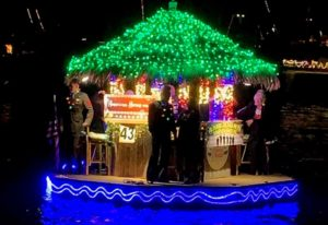 A floating Christmas-light bedazzled tiki hut bar