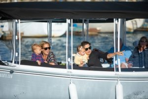 Moms and their kids enjoying a boat tour on the harbor