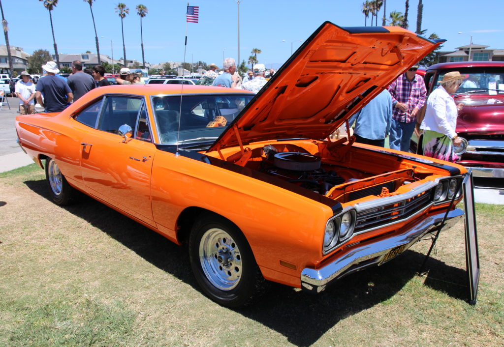 A mint Plymouth Roadrunner with its hood popped at the CIH Father's Day car show